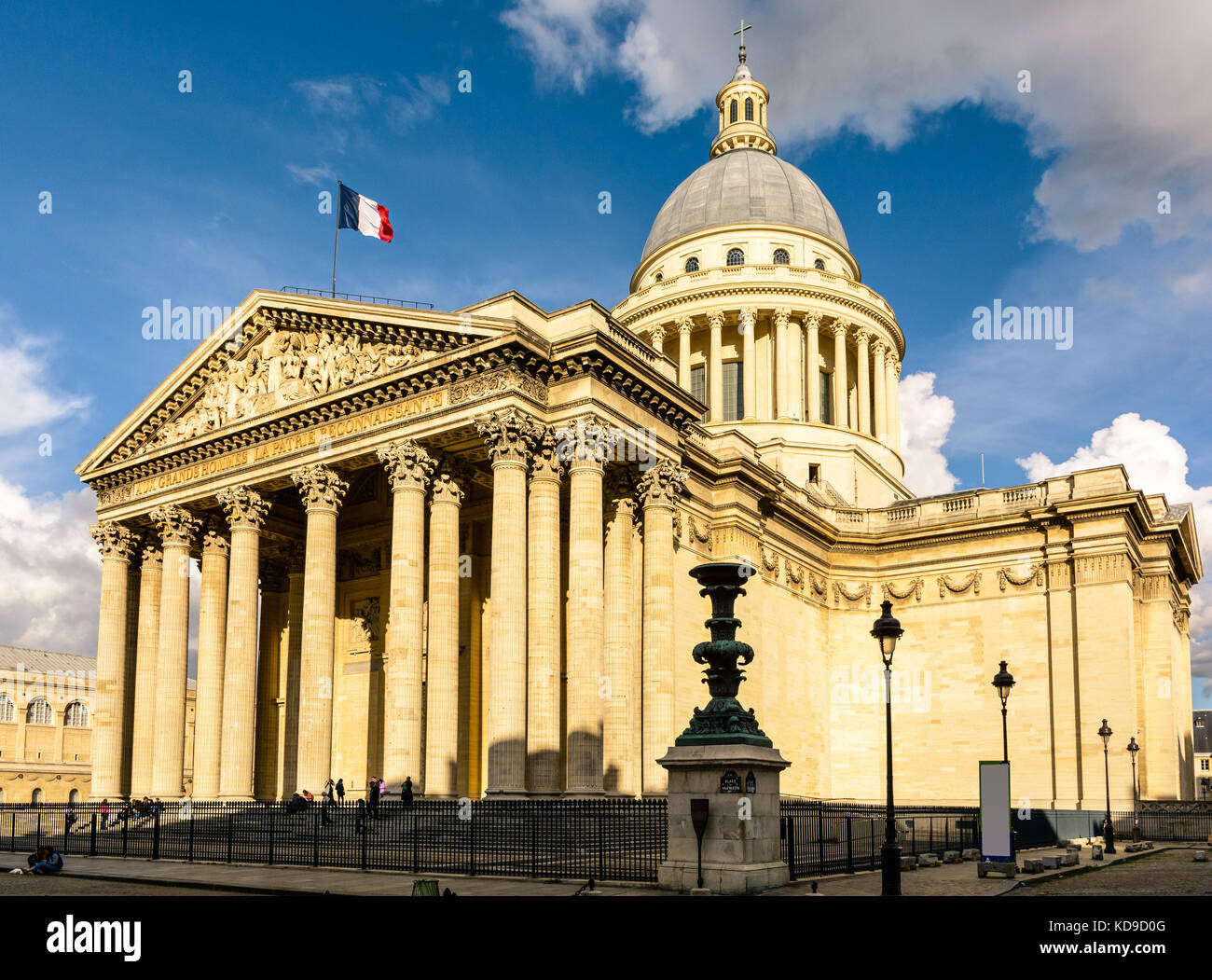 Three-quarter view of the Pantheon in Paris at sunset with the french flag flying in the wind. - Stock Image