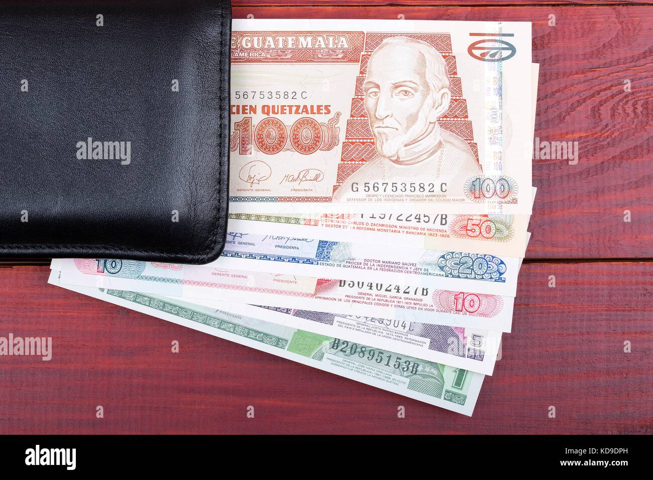 Guatemalan money in the black wallet - Stock Image