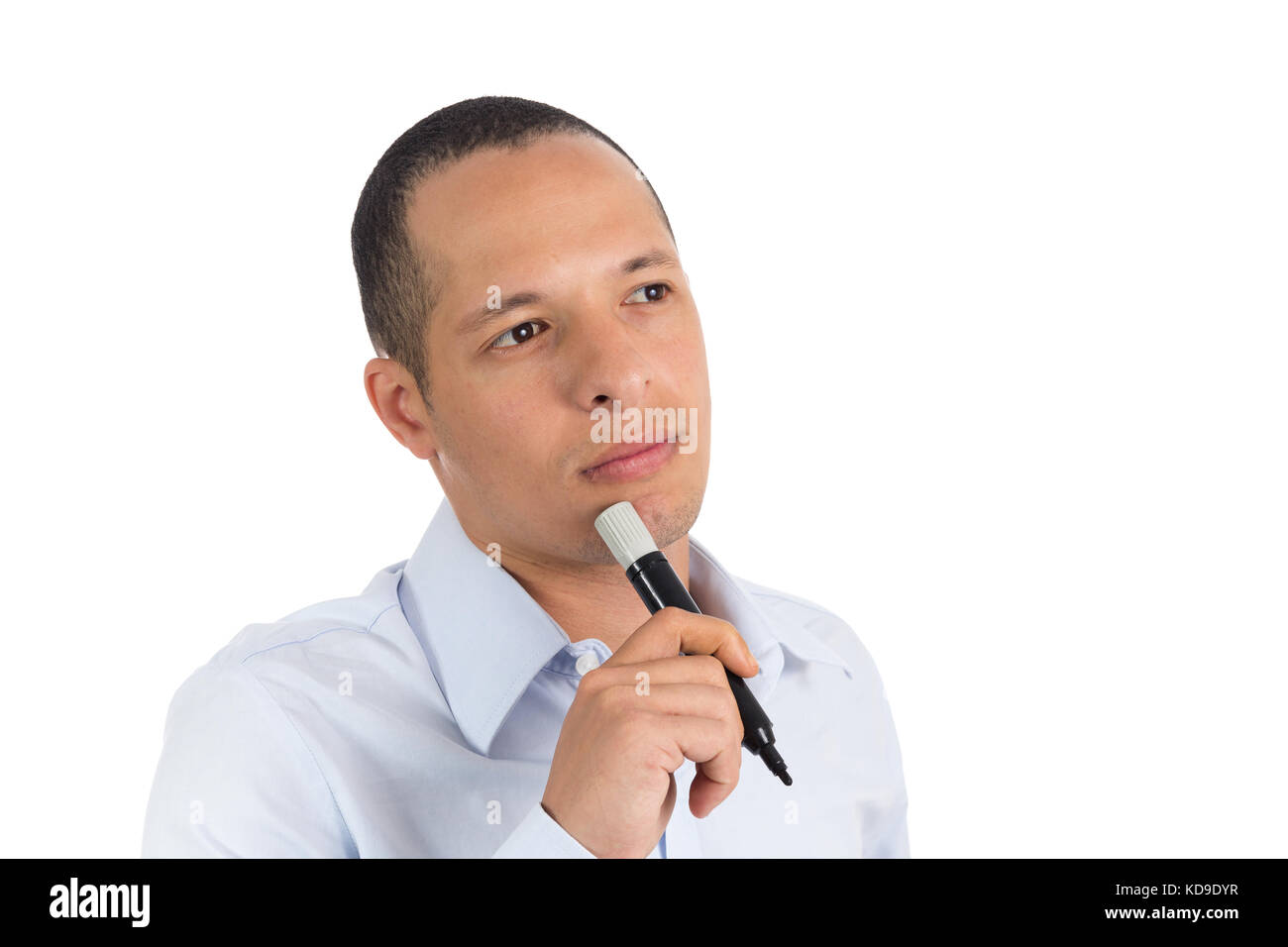 Entrepreneurial man holds a black permanent marker. Isolated person on white background, he wears light blue social - Stock Image