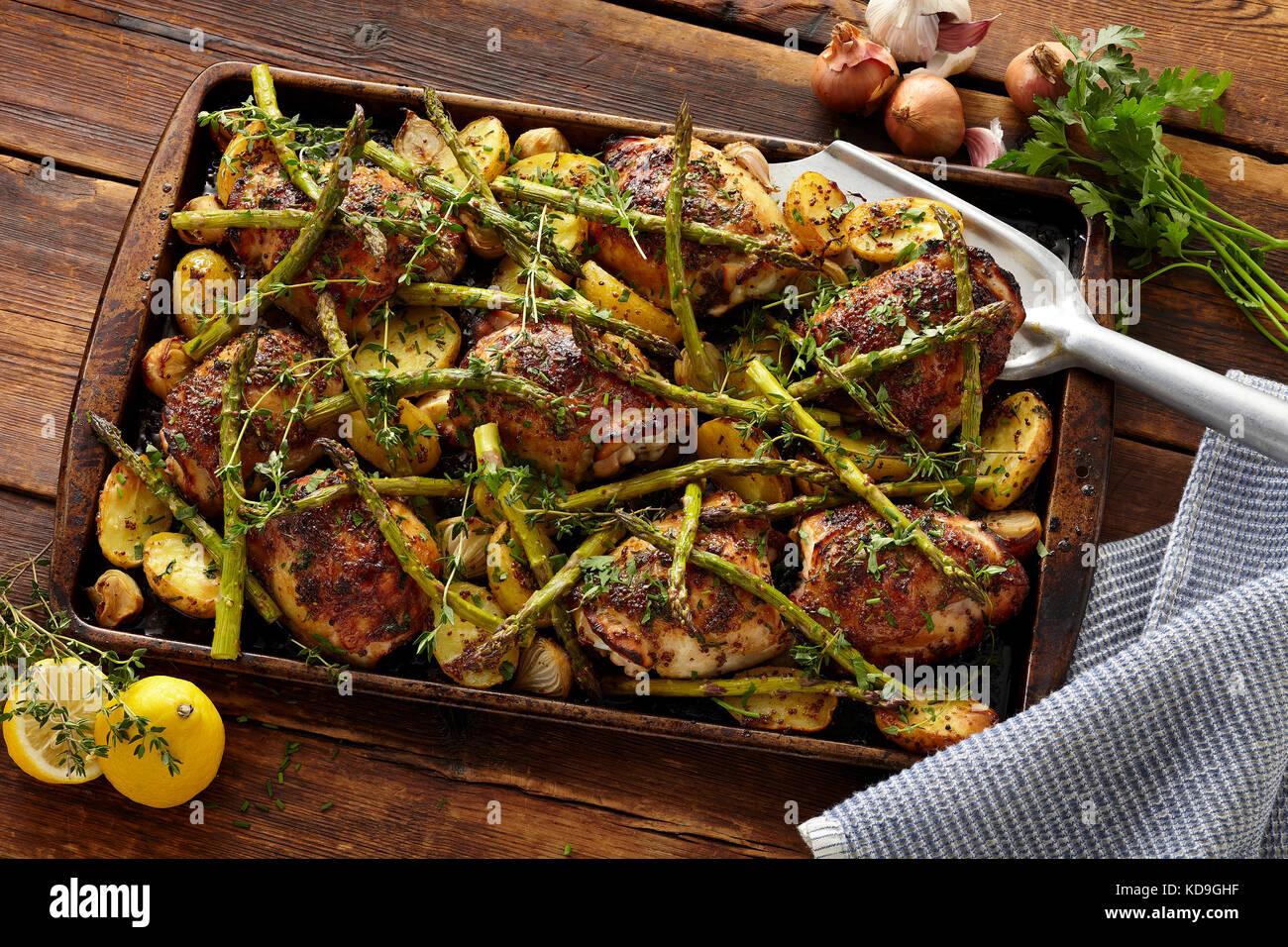 Sheet-pan honey Dijon chicken and asparagus - Stock Image