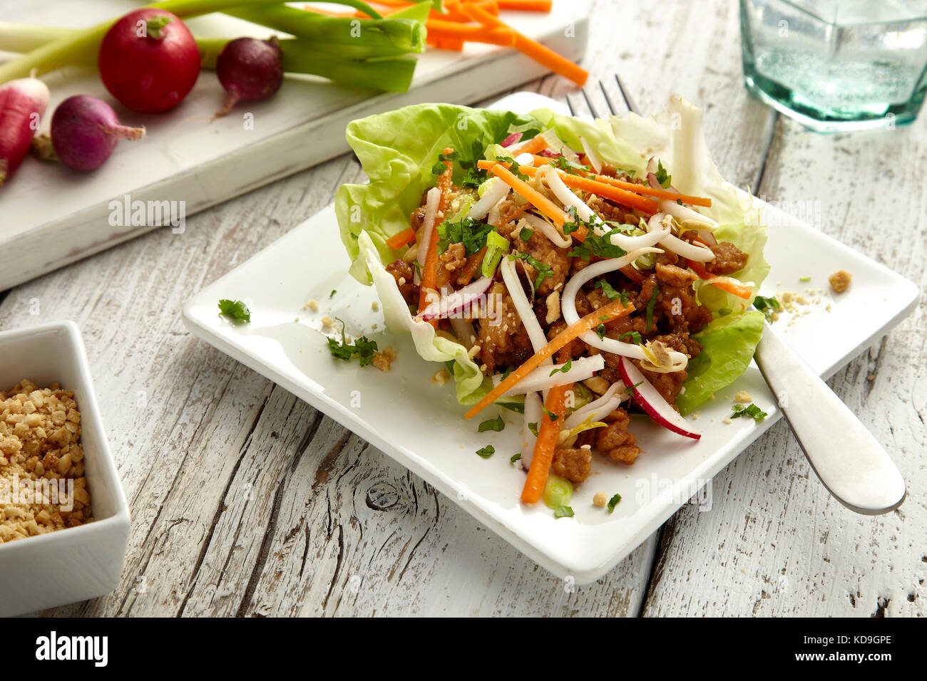 Honey peanut chicken lettuce cups - Stock Image
