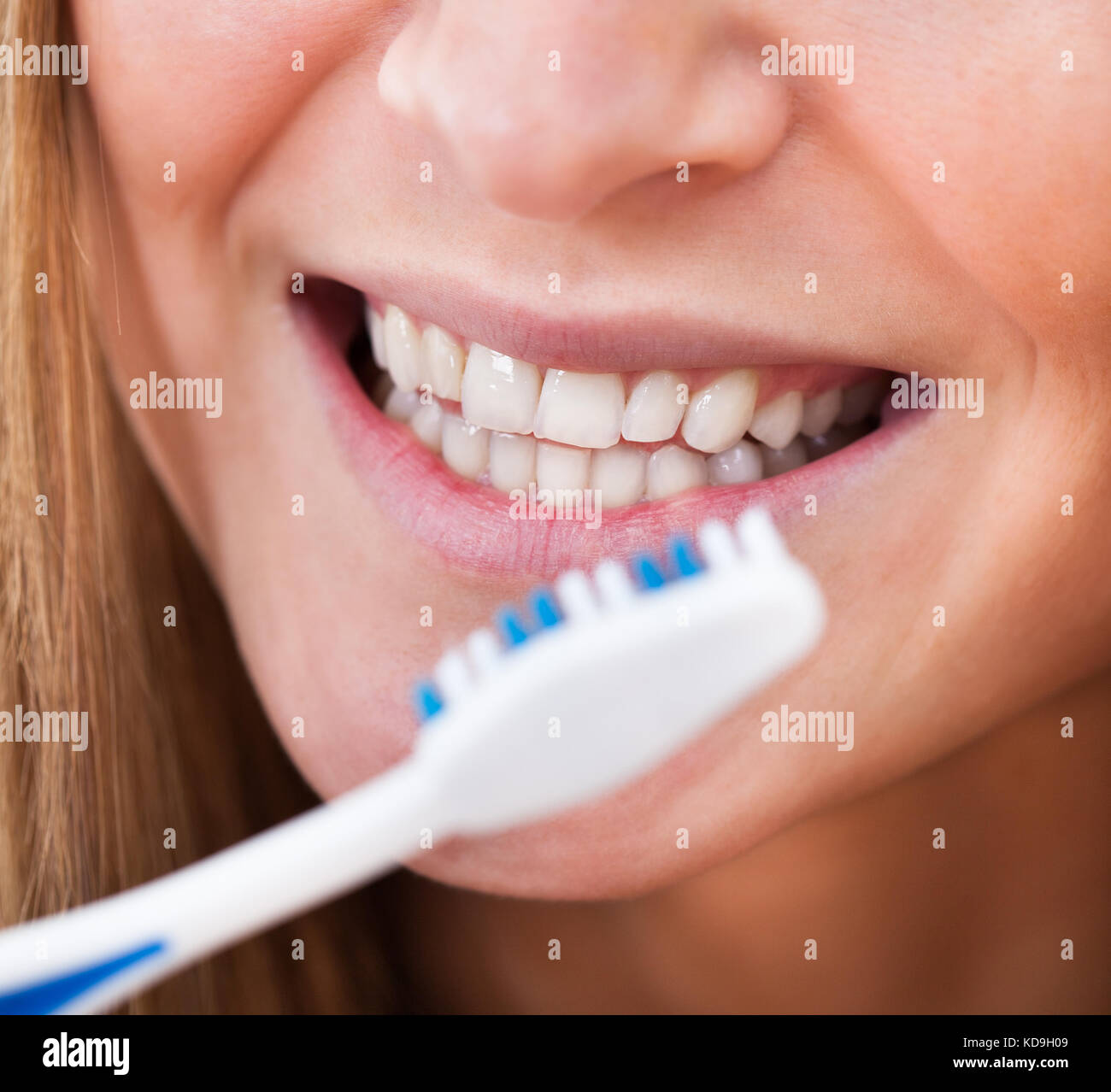 Close-up Of A Woman Brushing Her Teeth - Stock Image