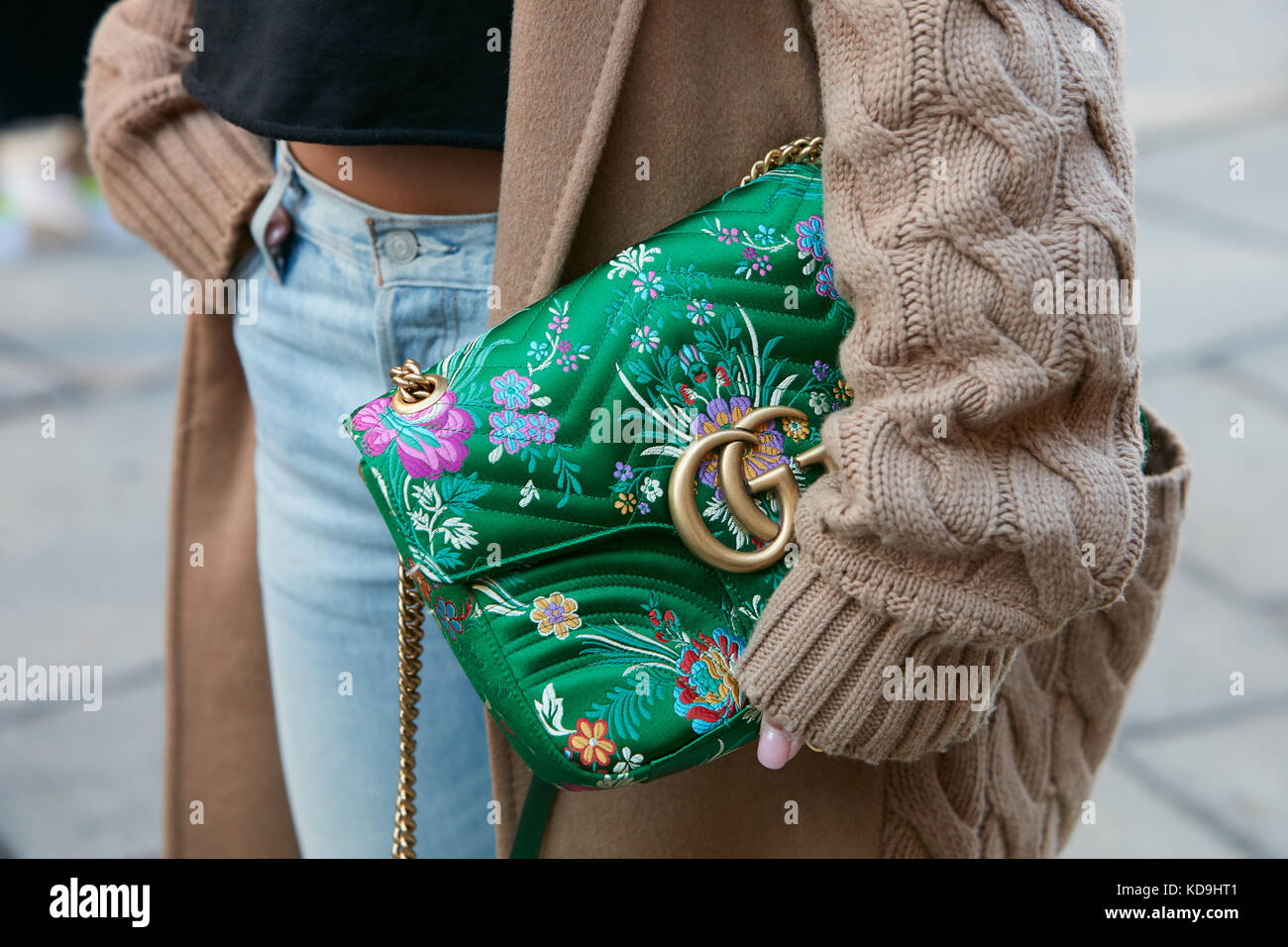 4bad37ce55d MILAN - SEPTEMBER 21  Woman with green floral design Gucci bag and beige  wool sweater
