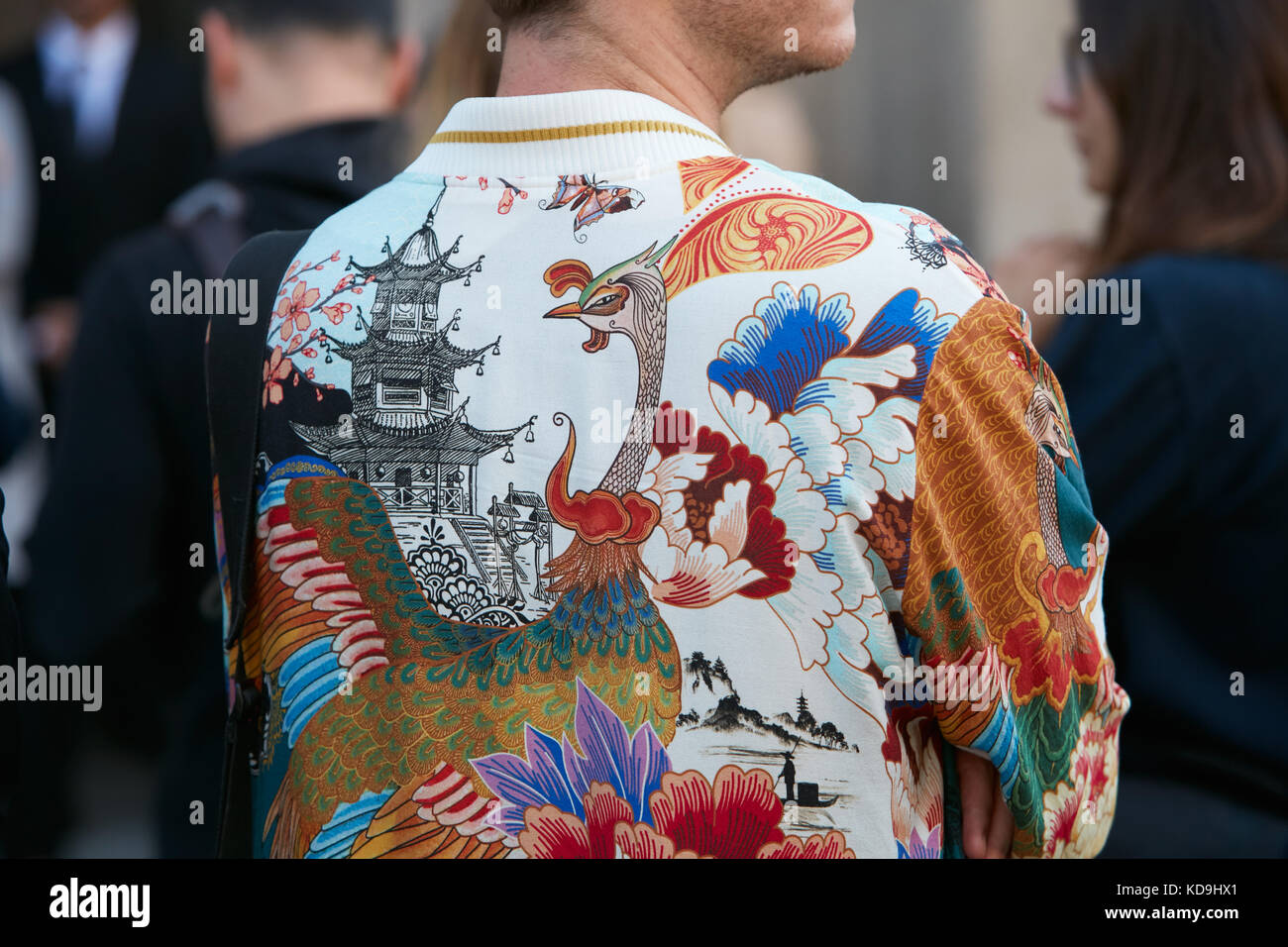 612452660 MILAN - SEPTEMBER 21: Man with bomber jacket with oriental floral decoration  with peacock and