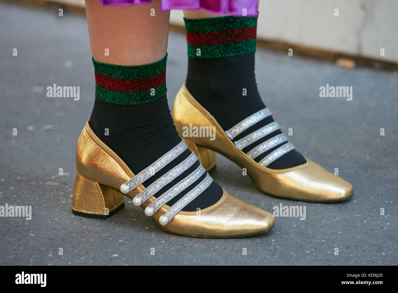 d28383b8a8a MILAN - SEPTEMBER 21  Woman with golden shoes with silver glitter belts and  Gucci socks before Fendi fashion show