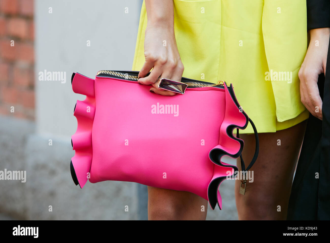 MILAN - SEPTEMBER 21  Woman with vibrant pink leather bag a49aa5df017db