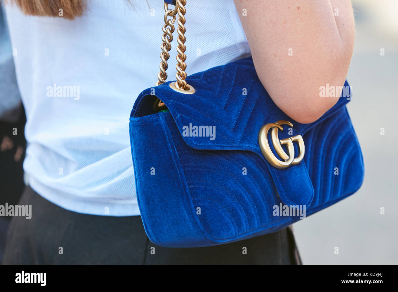 6a8b471b4 MILAN - SEPTEMBER 21: Woman with Gucci blue velvet bag with golden chain  before Prada fashion show, Milan Fashion Week street style on September 21,  2