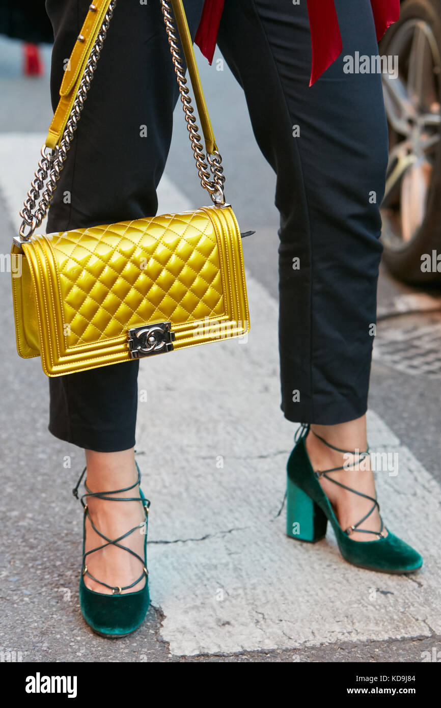 285ec4c1ee70 MILAN - SEPTEMBER 21: Woman with yellow Chanel bag and green velvet high  heel shoes before Prada fashion show, Milan Fashion Week street style on  Sept