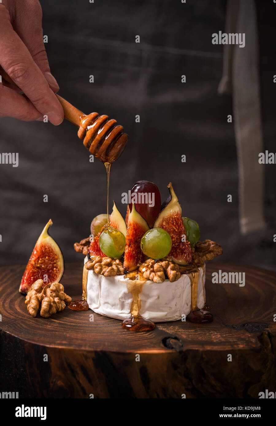 Cooking dessert with camembert cheese, figs and honey - Stock Image