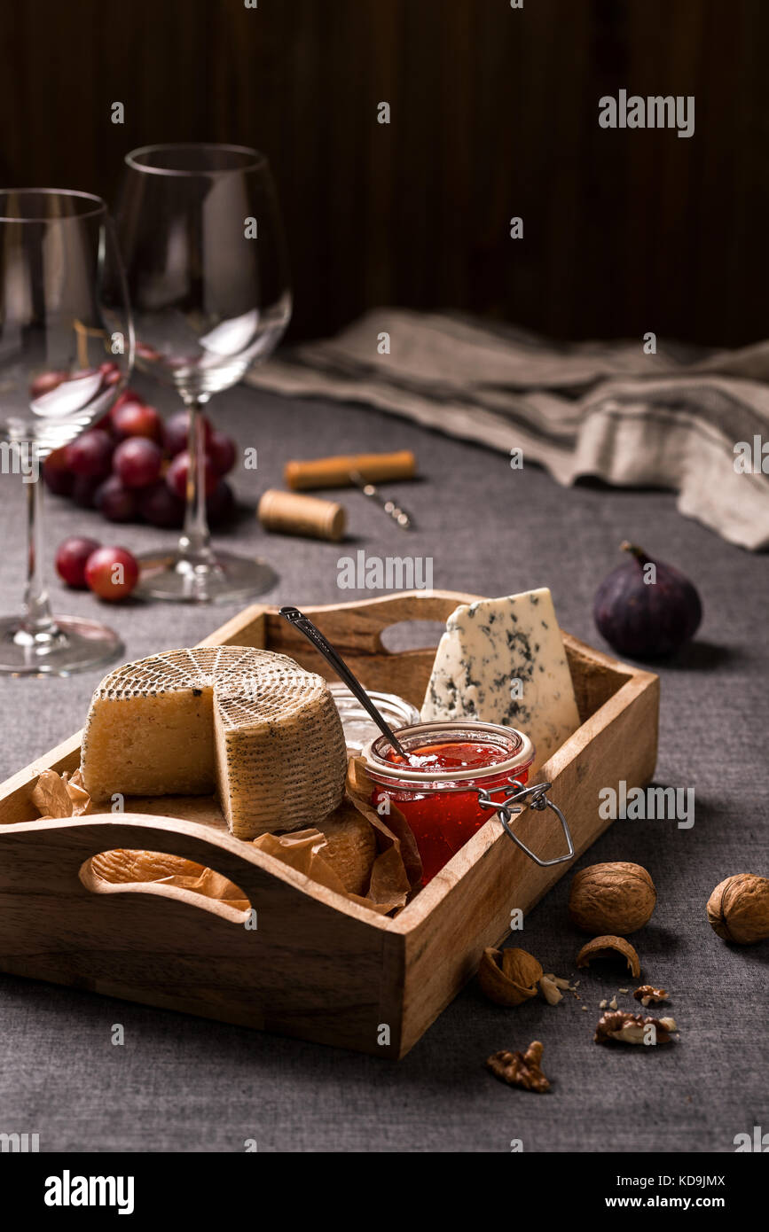 Cheese platter, nuts and fruits - Stock Image