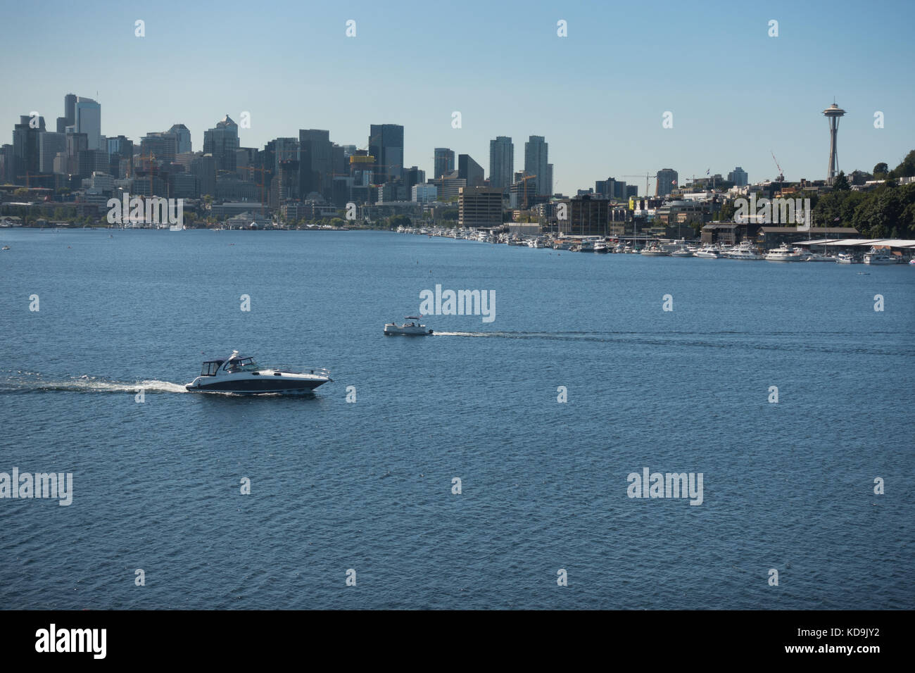 Pleasure boat on Lake Union, Seattle. Seattle skyline backdrop to scenic Lake Union viewed from Gas Works Park; - Stock Image