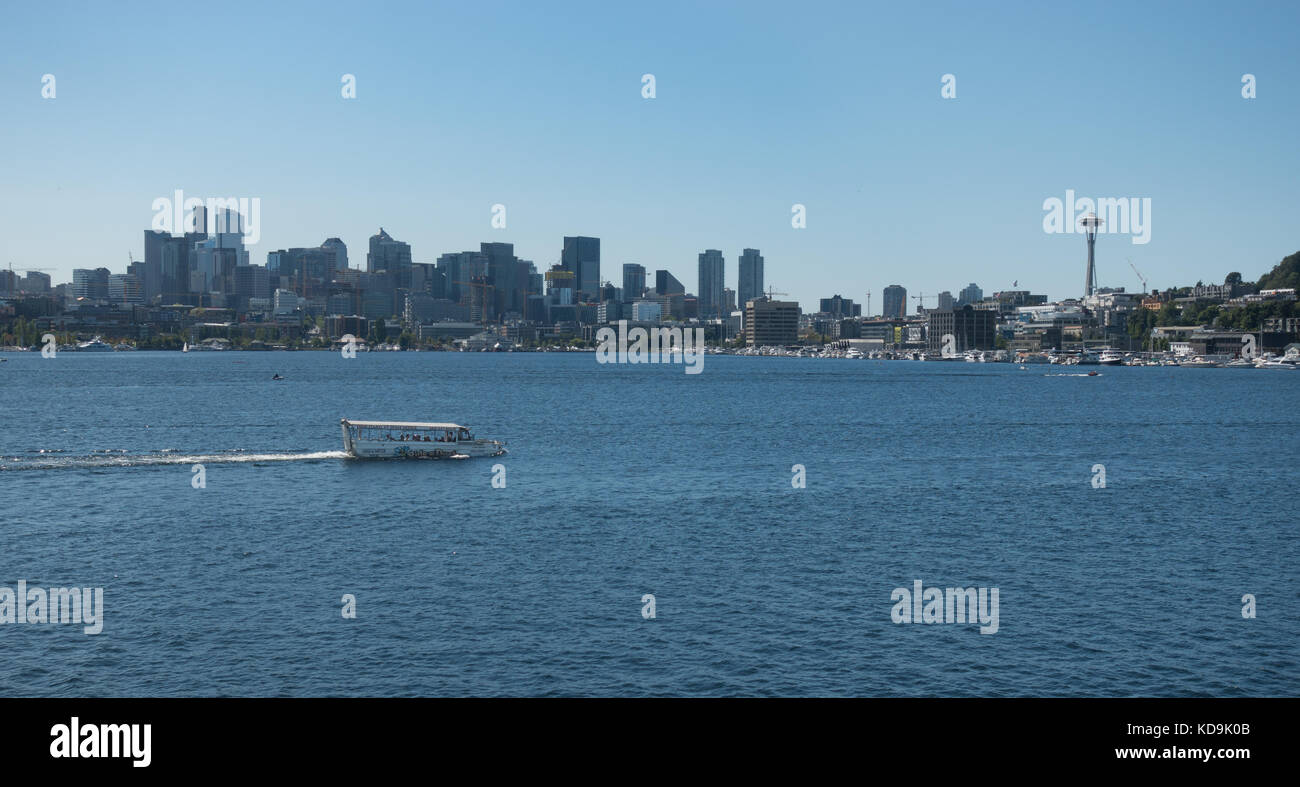 Tourist popular Duck Boat amphibious ride on scenic Lake Union, Seattle Skyline, Space Needle, construction cranes - Stock Image