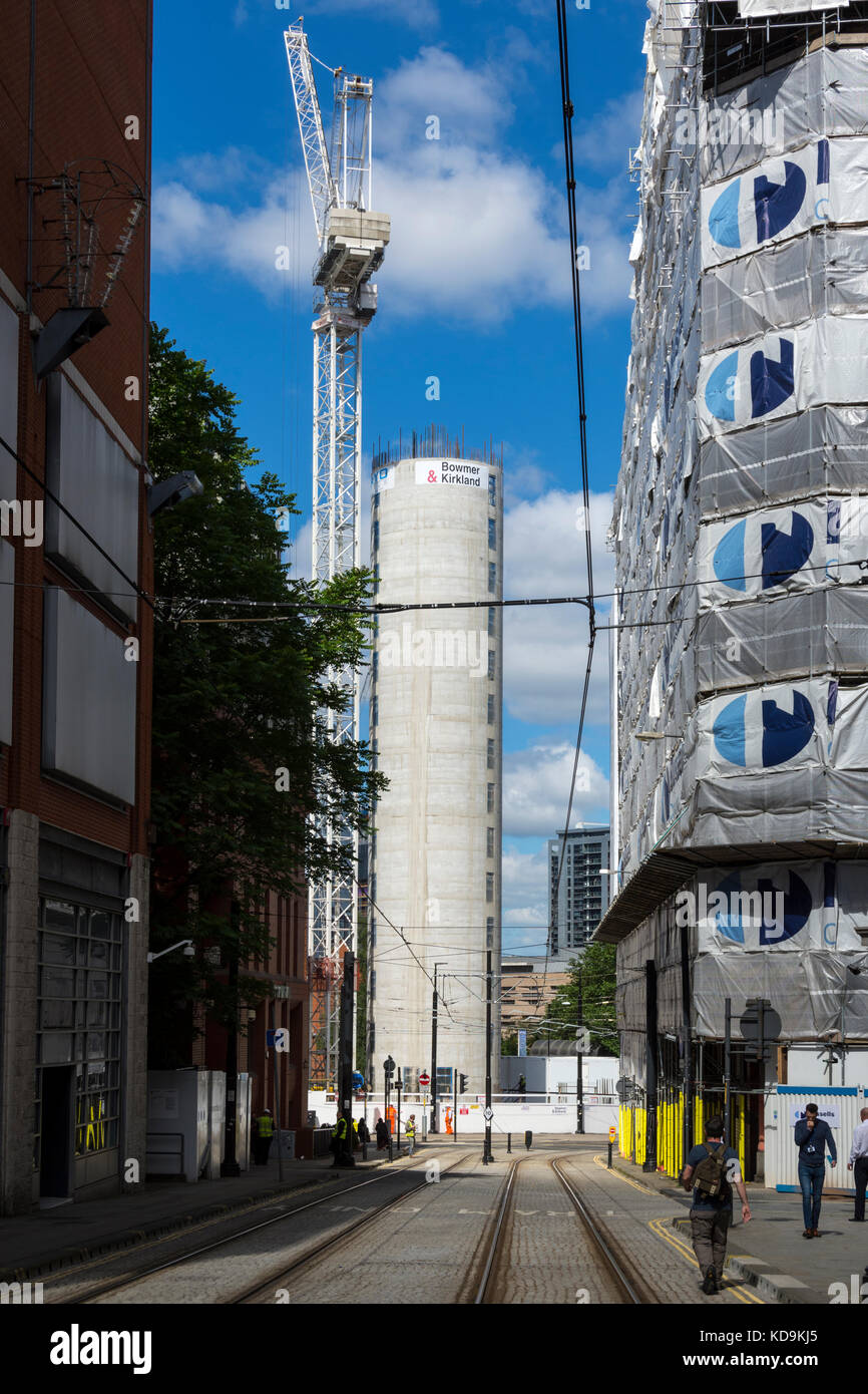 The central core of the Hotel Indigo building under construction, from Balloon Street, Manchester, England, UK - Stock Image