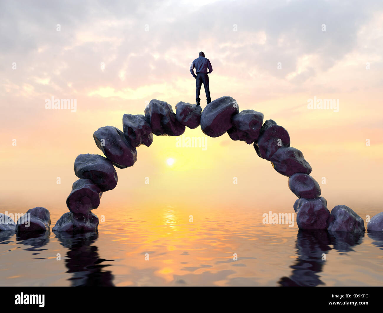 man stands on top of a stone bridge - Stock Image