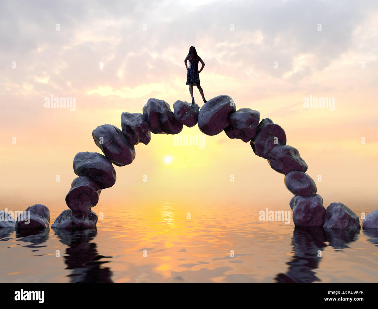 woman stands on top of a stone bridge - Stock Image