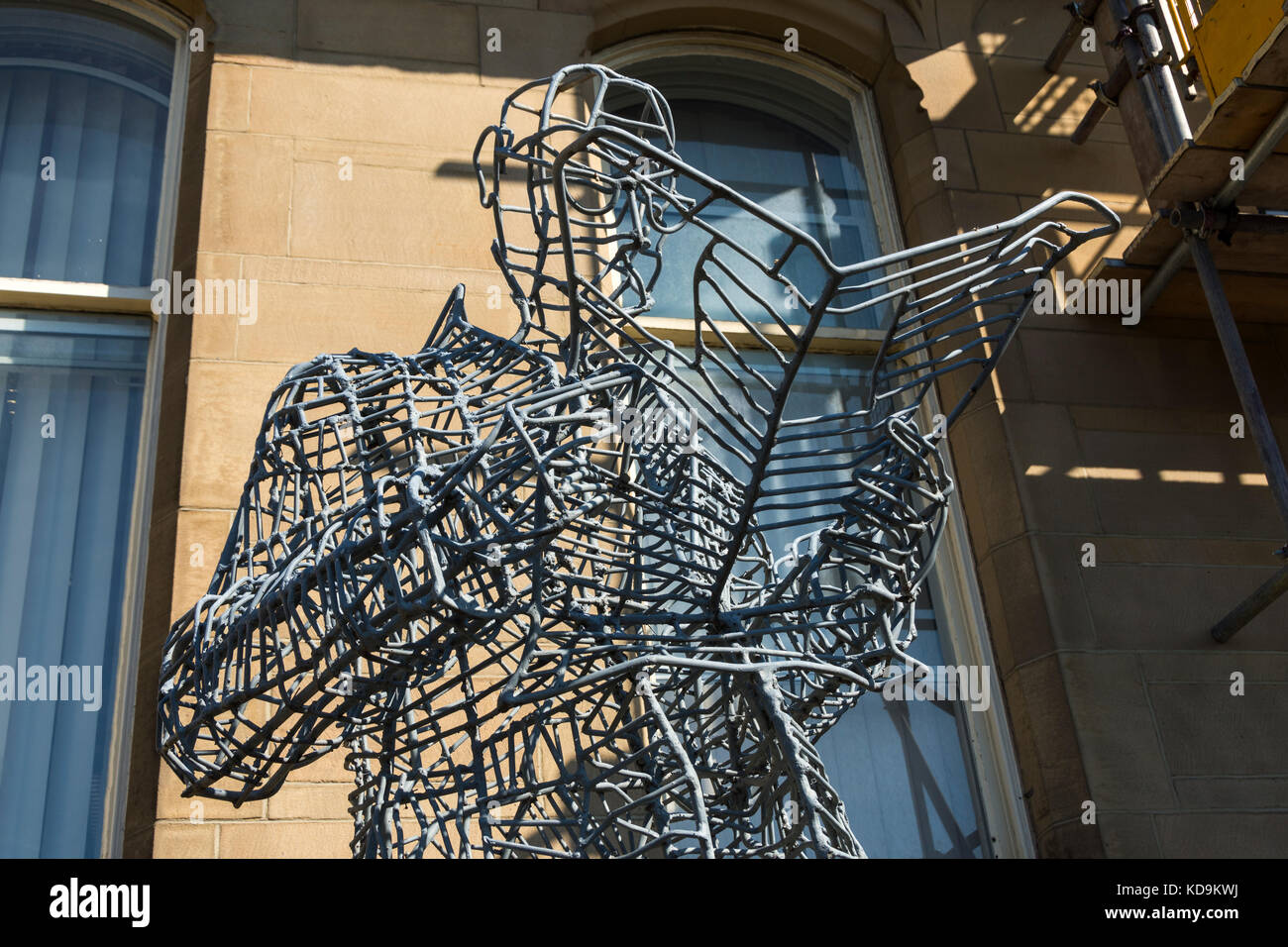 Wire sculpture of a man reading a newspaper, outside the Library ...