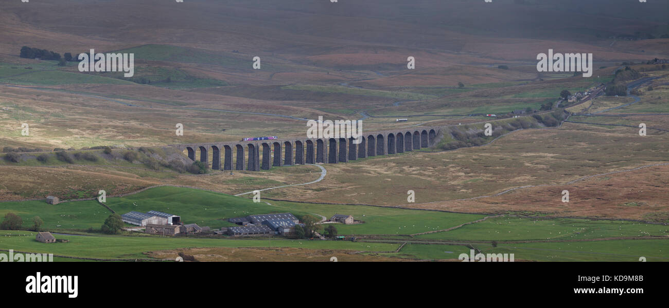 Ribblehead viaduct Northern rail class 158 express sprinter train working the a Carlisle to Leeds train on the  - Stock Image
