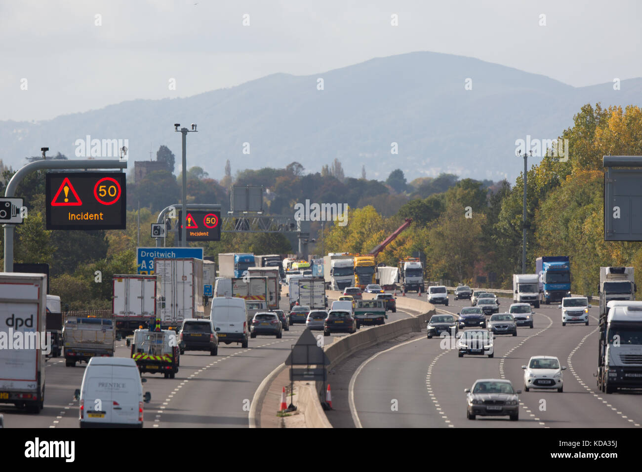 Droitwich, UK. 12th Oct, 2017. Recovery vehicles on the scene at UK M5 motorway, near Droitwich, rescuing HGV lorry from embankment. Traffic delays continue. Credit: Lee Hudson/Alamy Live News Stock Photo