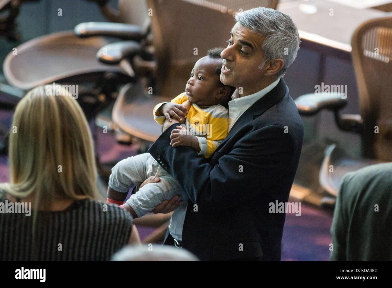 London, UK. 12th Oct, 2017. Mayor of London Sadiq Khan holds the son of Labour London Assembly Member Florence Eshalomi, - Stock Image
