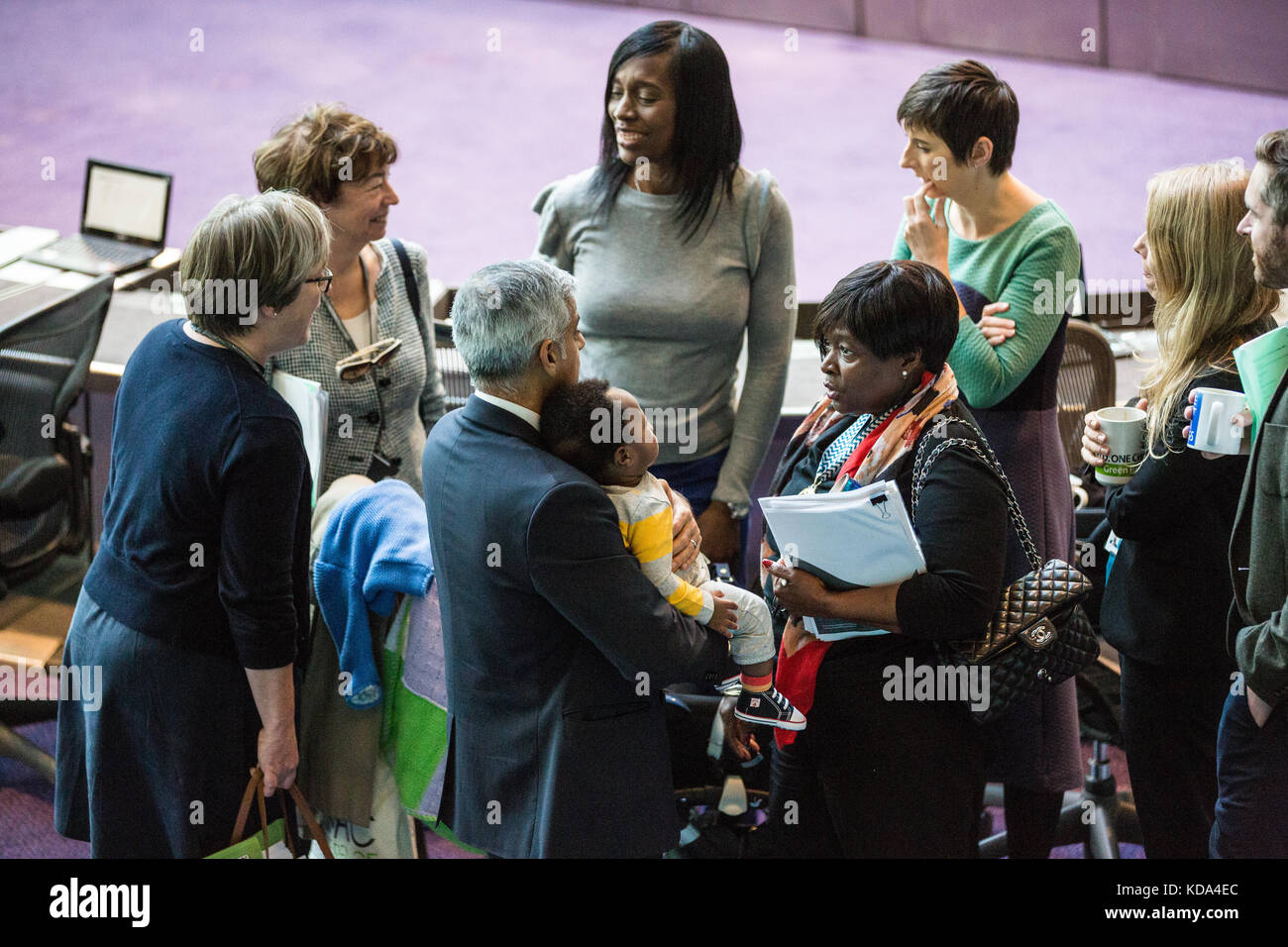 London, UK. 12th Oct, 2017. Mayor of London Sadiq Khan holds the son of Labour London Assembly Member Florence Eshalomi - Stock Image