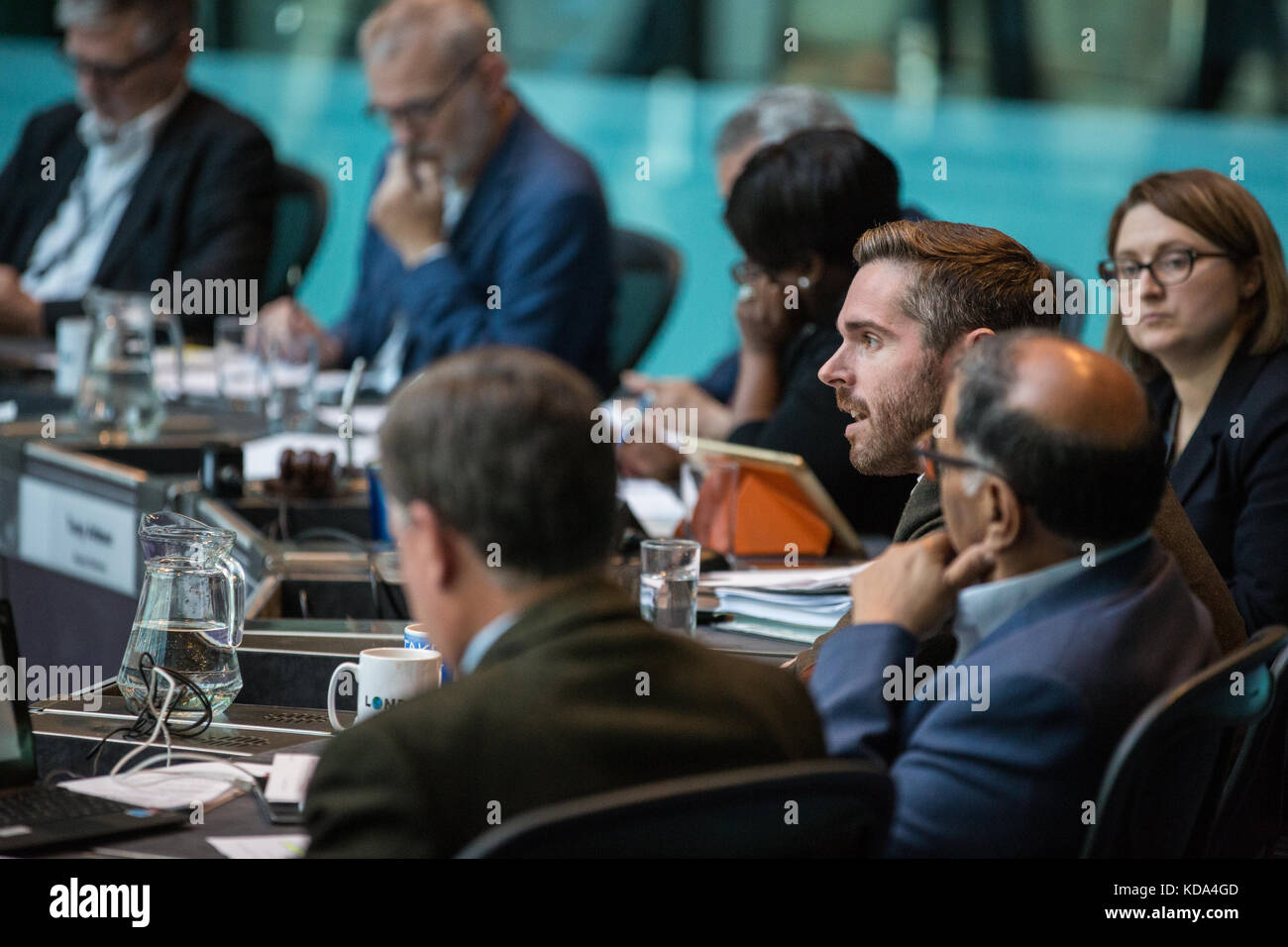 London, UK. 12th Oct, 2017. Tom Copley, Labour London Assembly Member, puts a question regarding micro flats to Stock Photo