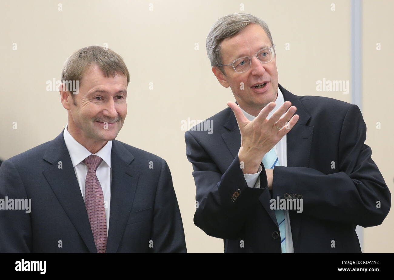 Sochi, Russia. 12th Oct, 2017. Siemens AG Management Board Member Klaus Helmrich (L) and Michael Harms, executive - Stock Image