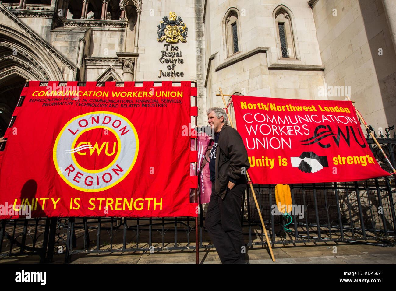 London, UK. 12 October 2017. Union banners outside of the High Court. Members of the Communications Workers Union - Stock Image