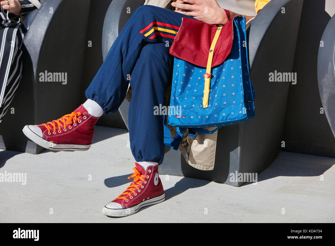 dee8e3d33d0 MILAN - SEPTEMBER 20  Man with Natwee red and blue backpack and red Converse  shoes
