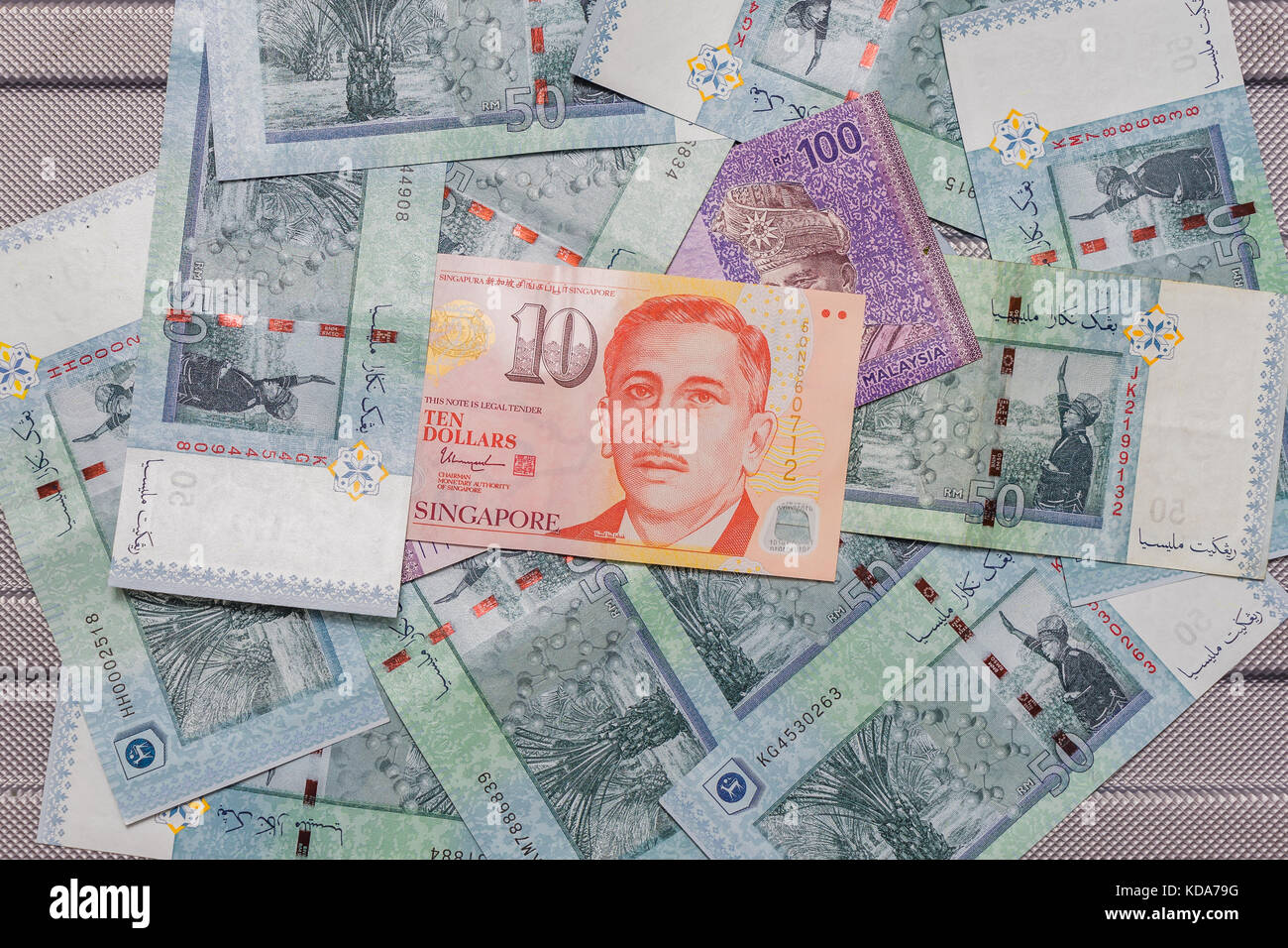 Singapore Dollar On Top Of Malaysian Ringgit Currency On Pattern