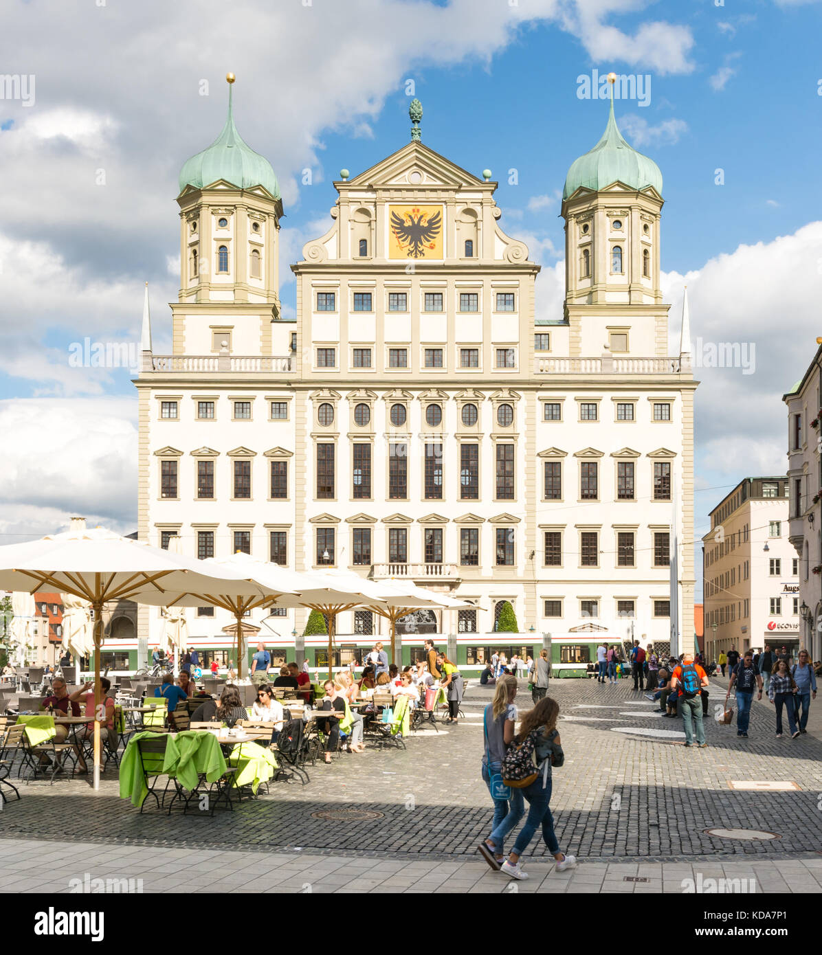 AUGSBURG, GERMANY - AUGUST 19: Tourists at the Rathausplatz in Augsburg, Germany on August 19, 2017. Augsburg is - Stock Image