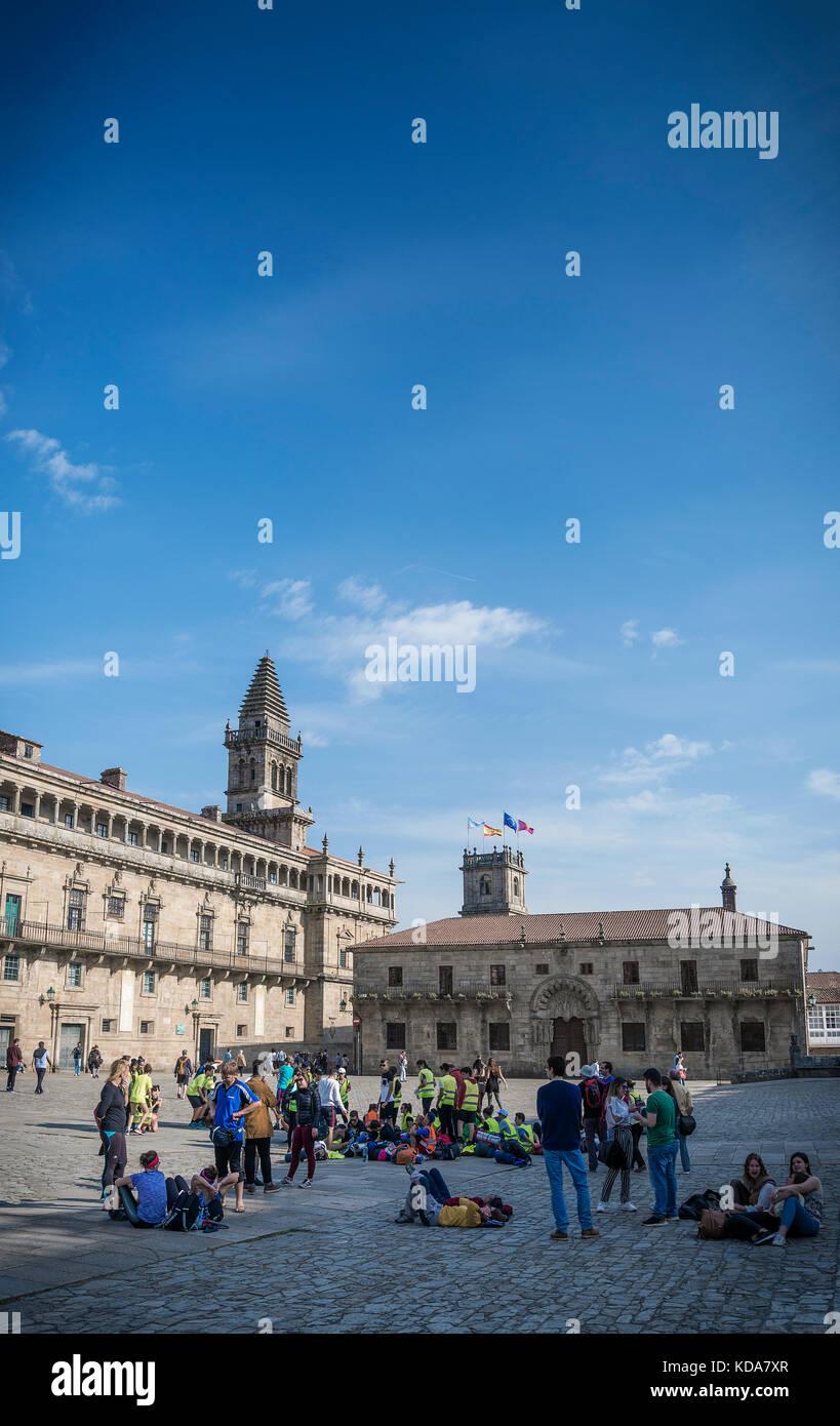 tourists at old town landmark Obradoiro Square near santiago de compostela cathedral spain - Stock Image