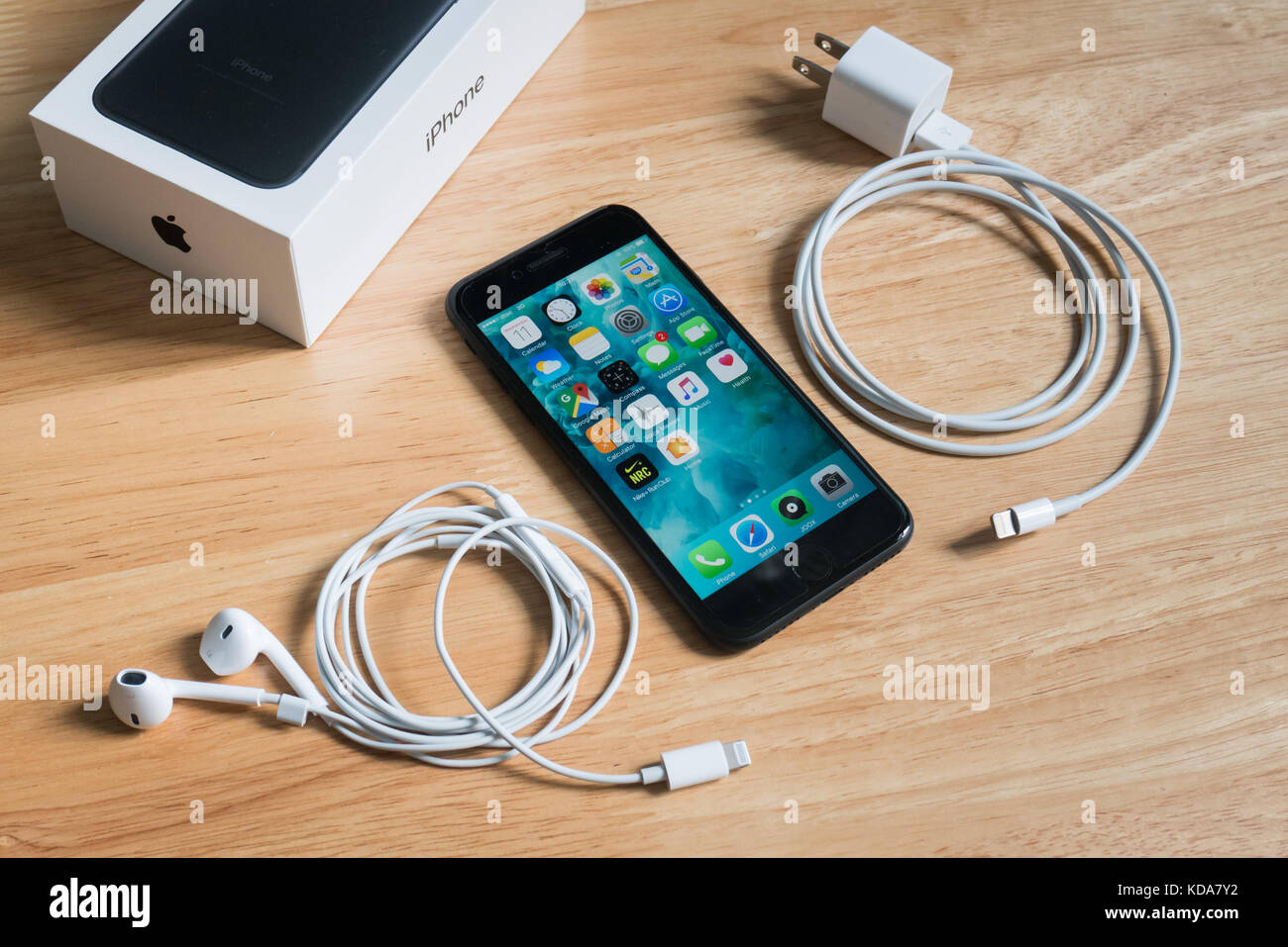 Bangkok, Thailand - October 11, 2017 : Apple iPhone 7 with Earpods, power adapter and the box package. Stock Photo