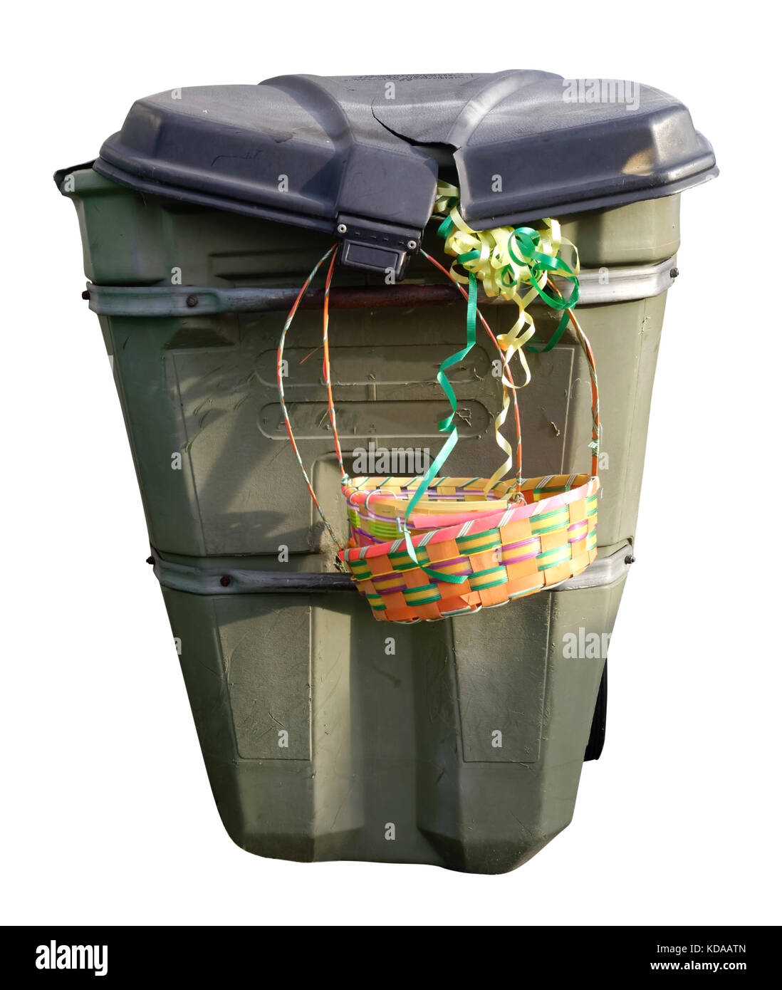 Easter basket hanging from isolated shabby trash can - Stock Image
