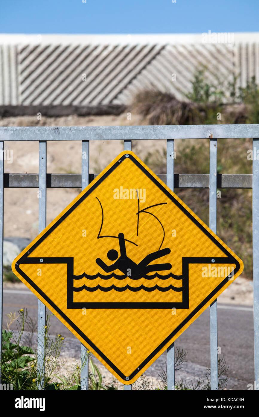 Flash flood warning sign next to Los Angeles River, Long Beach, California, USA Stock Photo