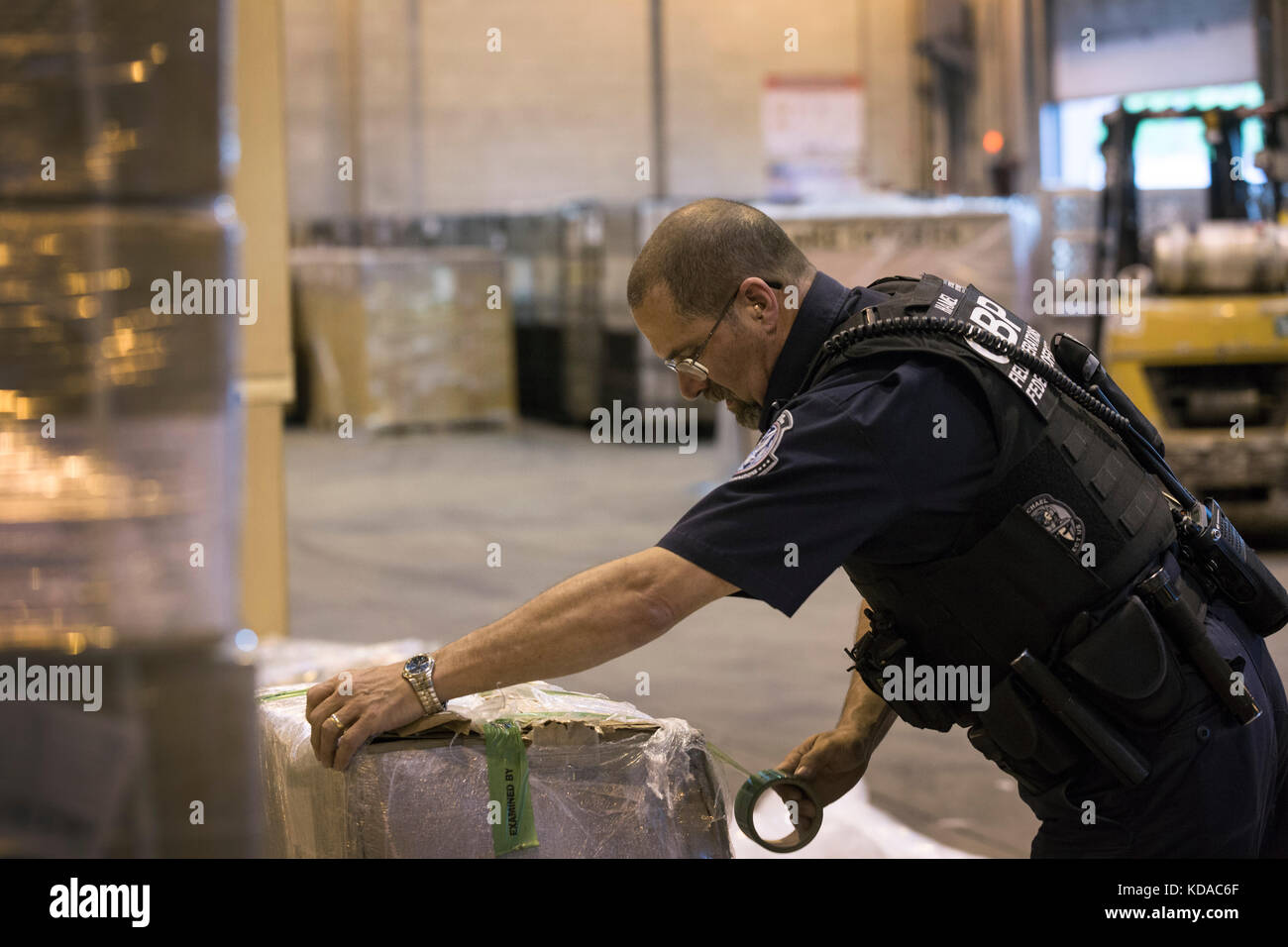 U.S. Customs and Border Protection Field Operations officers inspect incoming shipments for contraband at the Boston - Stock Image