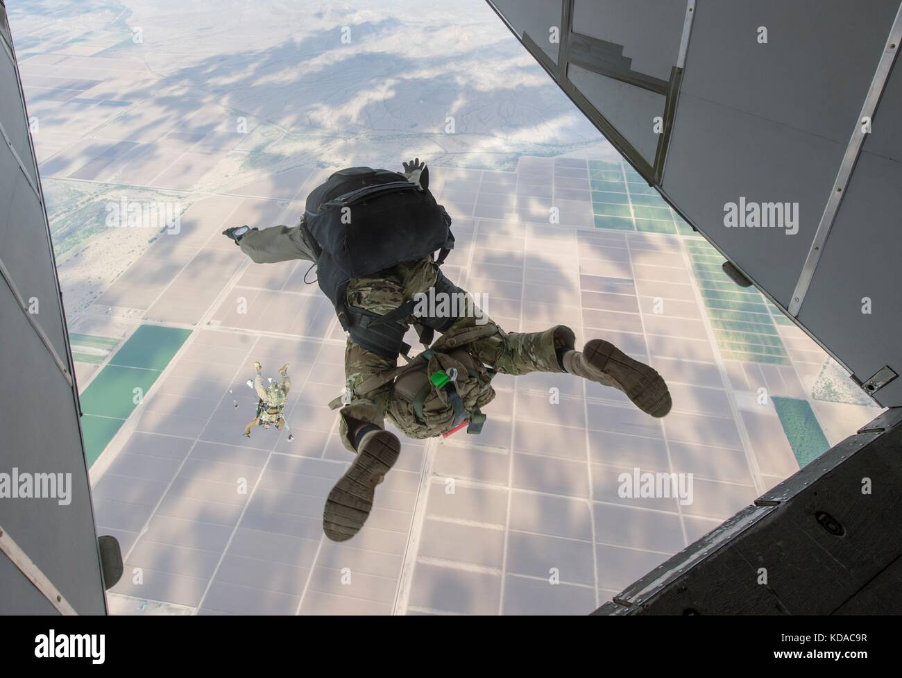 U.S. Navy SEALS jump out of a SC-7 Skyvan skydiving aircraft during free-fall training over the Skydive Arizona - Stock Image