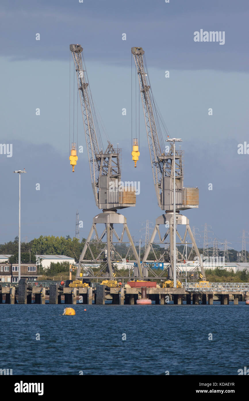 Two Dockside cranes in Southampton against a blue sky - Stock Image