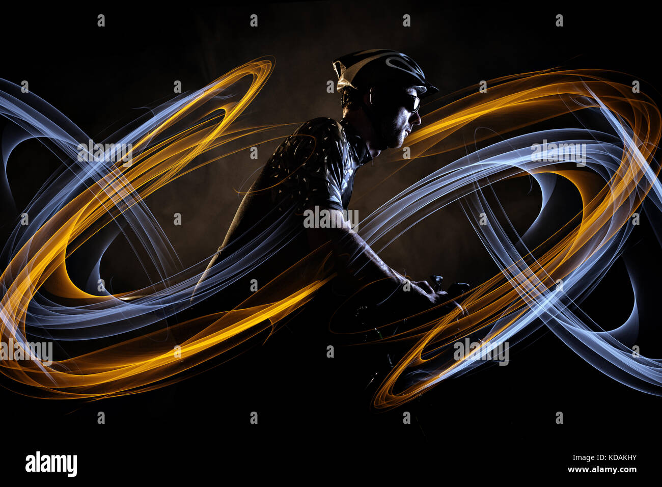 Cyclist with dynamic light effect - Stock Image