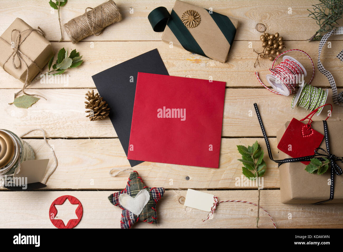 Empty Greeting Cards And Christmas Ornaments On Wooden Background