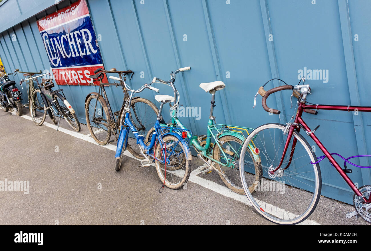 Historic bicycles parked against paddock panels at the 2017 Goodwood Revival, Sussex, UK. - Stock Image