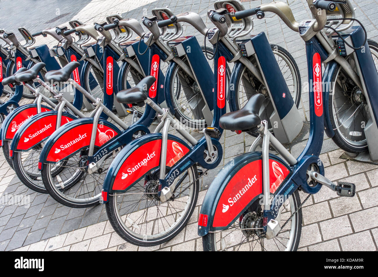 Transport for London - TFL - a line of parked Santander pay-as-you-go cycles, at a docking station in South Kensington, - Stock Image