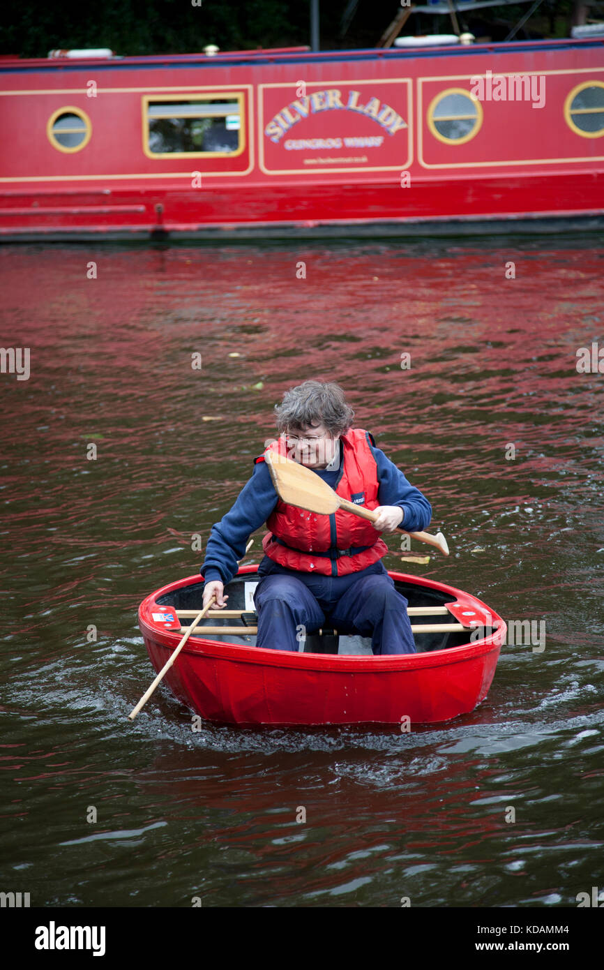 Coracle on a UK canal, Welsh borders - Stock Image