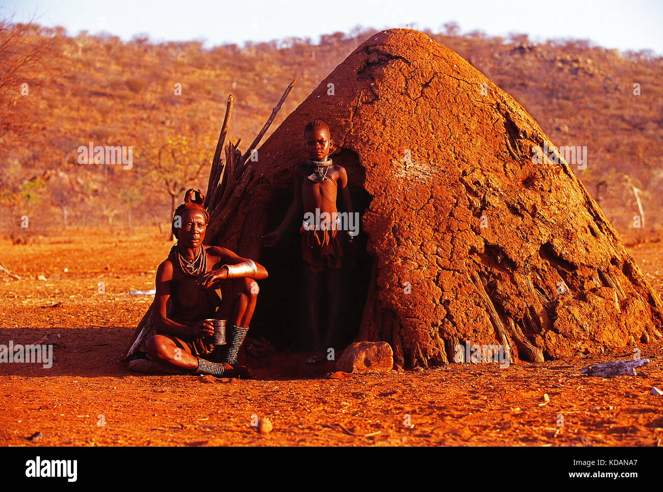 Africa. Namibia. Kunene region. Himba people. Father and son. - Stock Image