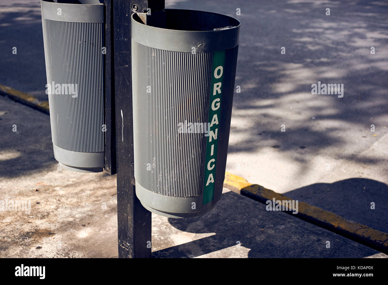 Organic and inorganic waste bins on Paseo de Montejo avenue in Merida, Yucatan, Mexico - Stock Image