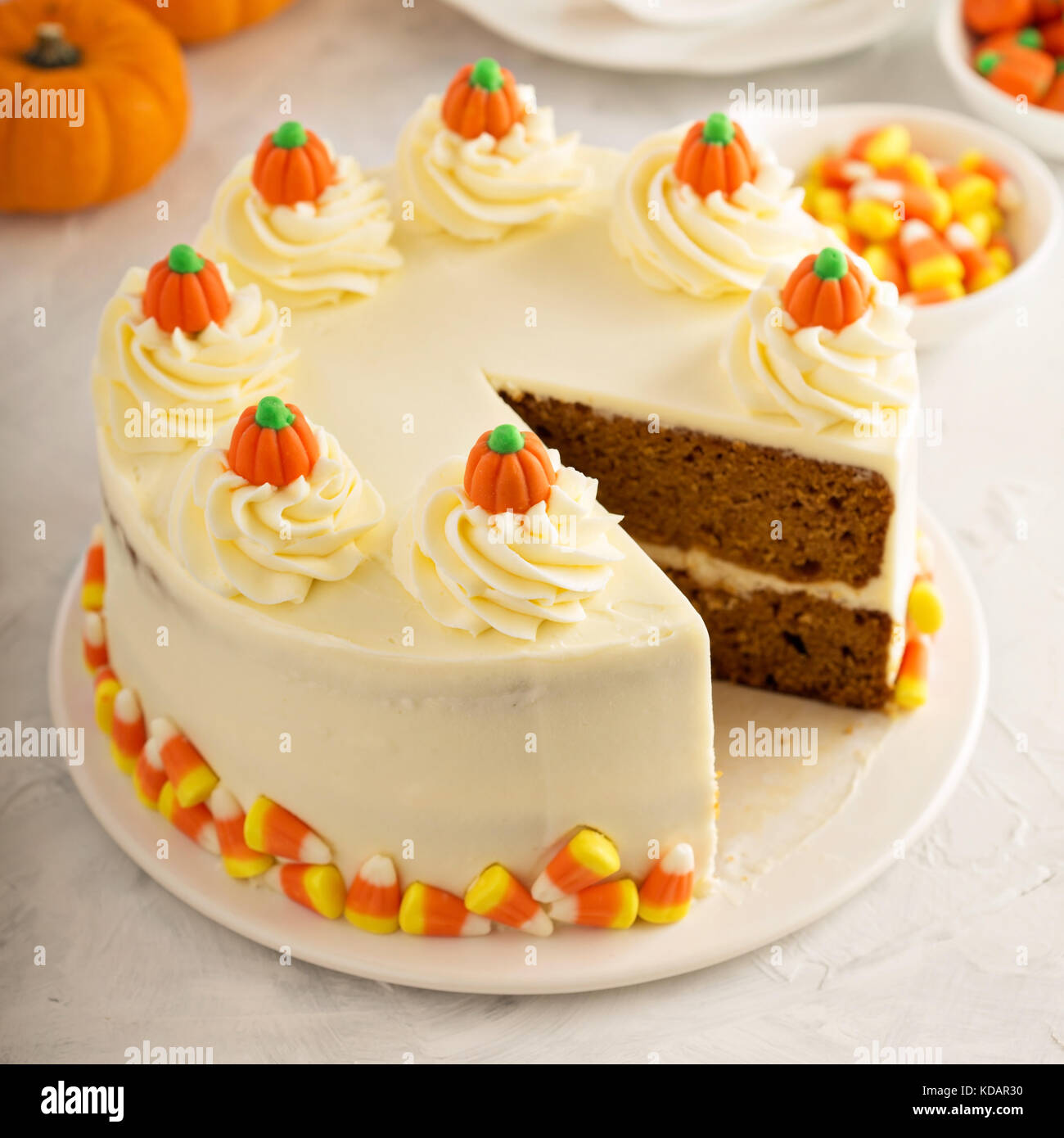 Pumpkin spice layered cake with cream cheese frosting - Stock Image
