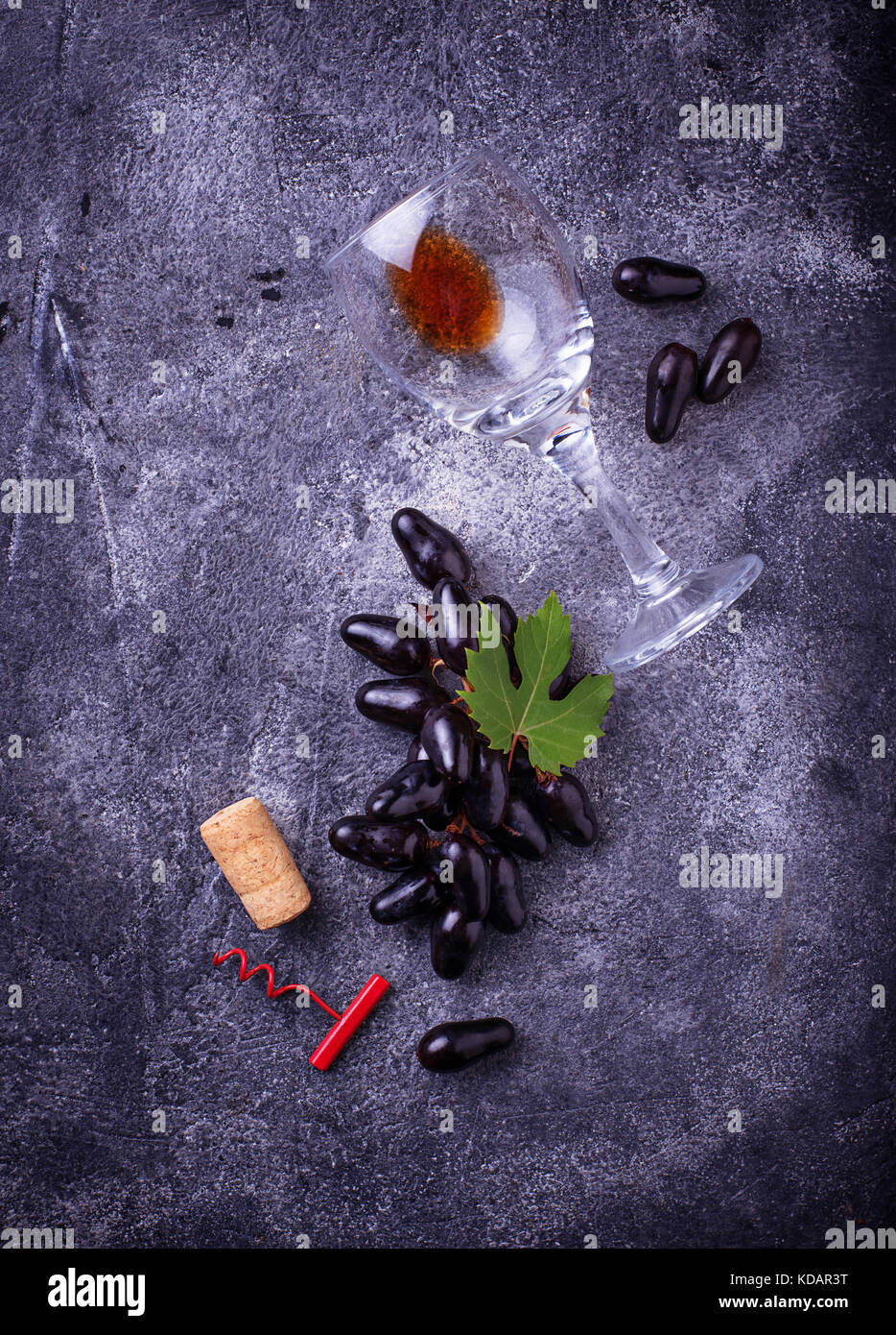 Grapes, red wine, glass, corkscrews and cork - Stock Image