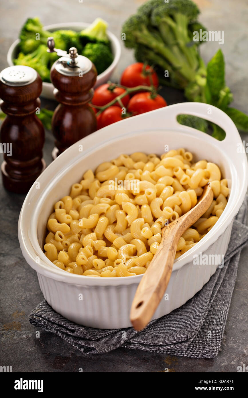 Mac and cheese in a baking dish - Stock Image