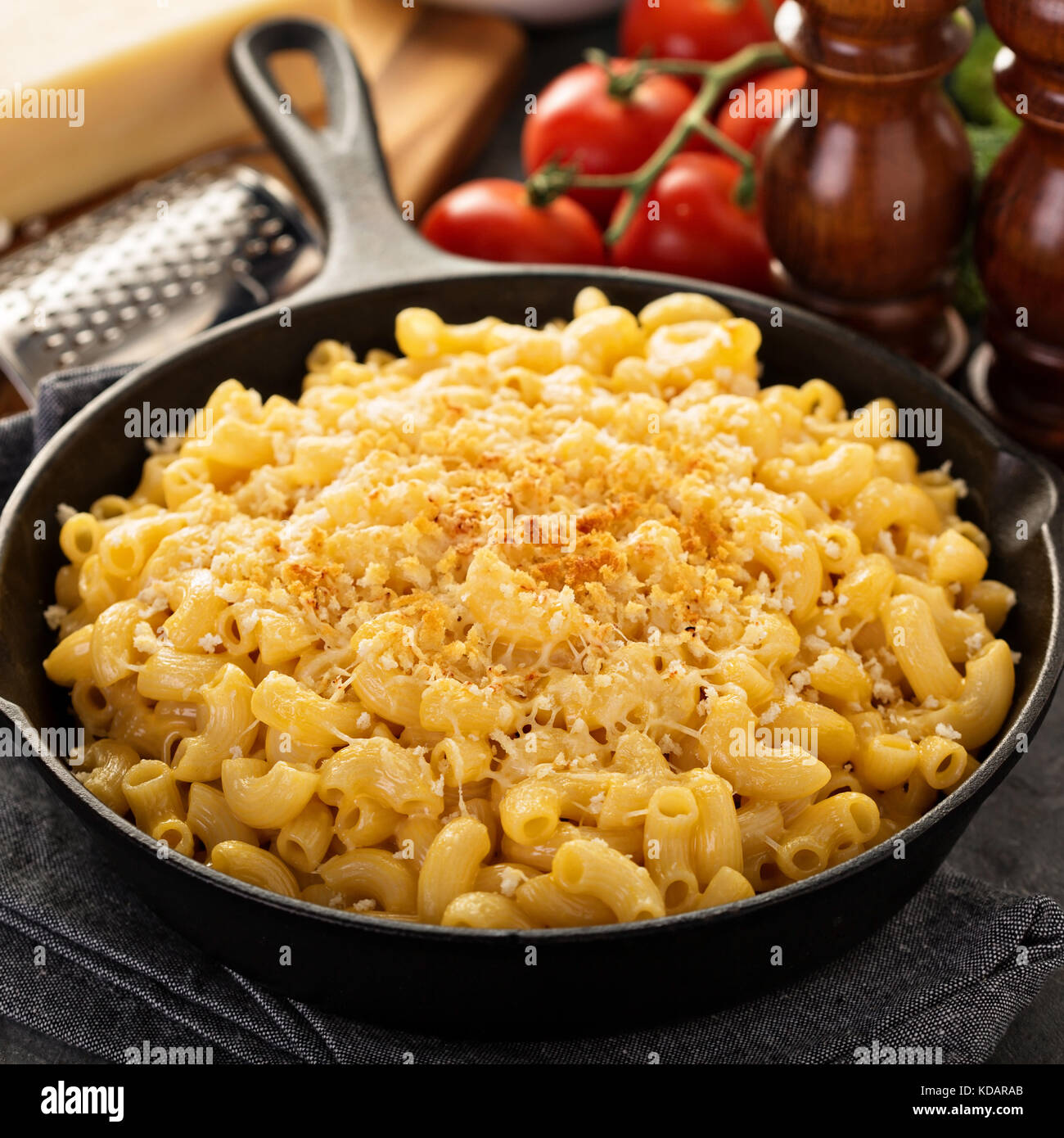 Mac and cheese in a cast iron pan - Stock Image