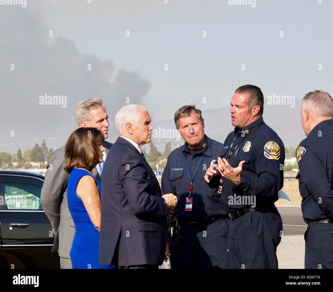 U.S. Vice President Mike Pence, Karen Pence and House Majority Leader Kevin McCarthy, left, speak with firefighters - Stock Image