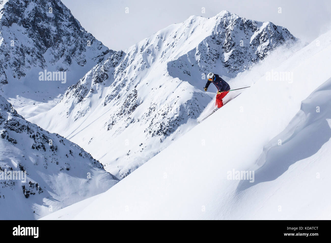 Extreme skier going through steep slope - Stock Image